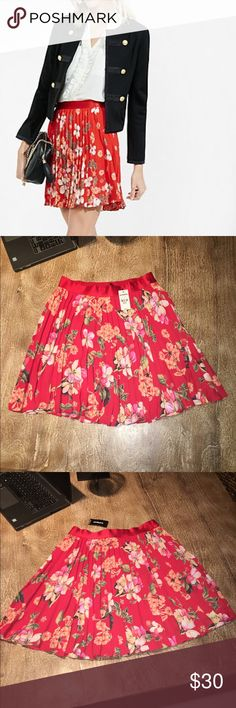 "Red Cherry Blossom Floral Pleated Mini Skirt XS NWT. Express Red Cherry Blossom Floral Pleated Mini Skirt. Size XS. Approx 17"" in length. Small snag noted - see picture of red satin waistband. Not noticeable. Never worn. Smoke free home. Express Skirts"