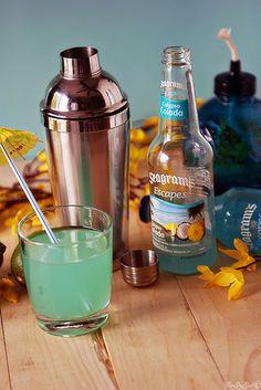 Tropical Breeze Cocktail with Calypso Colada, Coconut Rum, Orange Juice, & Lime