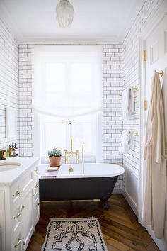 Images On Clawfoot tub in a tiny bathroom Subway tiles and brass hardware Tiny Bathrooms With Major Chic Factor via