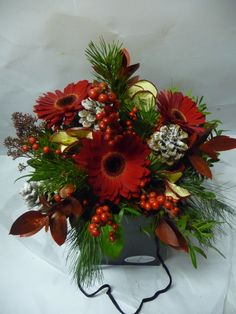 Festive seasonal bouquet of red Gerberas, berries, cones, fruit slices and foliages. Christmas Arrangements, Christmas Flowers, Table Centers, Festive, Berries, Floral Wreath, Bouquet, Wreaths, Seasons