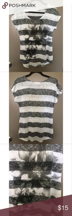 Agenda black and white top This is a beautiful black and white with floral design to by Agenda. The top is a size medium and is free of rips, tears, stains and missing stones. This is a great summer layering piece. Agenda Tops Blouses