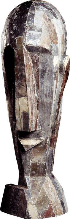 Paulo Laender - CABEÇA BIZARRA II - escultura em madeira revestida com chapa galvanizada - data 1991 - dim diam 35 x 130 cms