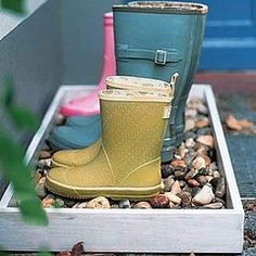 Box of decorative rocks to keep rainy boots