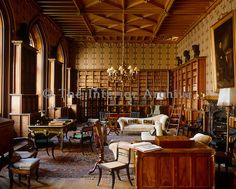 Bookcases filled with leatherbound volumes line the walls of this neo-gothic library at Belvoir Castle