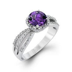 This show stopping and modern Blindingly Beautiful Collection ring focuses the attention on a single .97ct Amethyst and is supported with .37ctw of white diamonds set in 14K white gold.