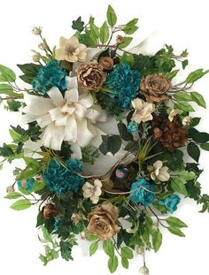 Luxury Floral Wreath with Cream Burlap Ribbon Bow  This beautiful uniquely handcrafted wreath is filled with gorgeous beige roses, beautiful teal blue and brown hydrangeas and ranunculas, ivory magnolias, bird nest with a bird, ivy greenery, honey suckle vine, mixed greens, ficus leaves and an ivor