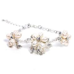 """This delicate floral design is at home in a garden or on the beach with its genuine freshwater pearls and just a touch of crystal detail. Setting is rhodium plated for a lasting shine. Measures an adjustable 7"""" to 9"""". Price $68.00"""