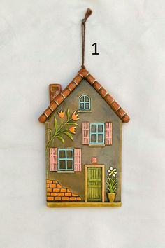 Embossed Ceramic House with louvered windows,wall decore This handmade ceramic is a beautiful addition to your indoor spaces. It is also an ideal gift for you or your beloved too. DIMENSIONS x x FEATURES Hand-formed and hand-glazed Made Clay Houses, Ceramic Houses, Miniature Houses, Clay Wall Art, Cardboard Art, Polymer Clay Crafts, Window Wall, Diy Home Crafts, Wooden Crafts