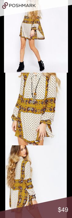 ✨ cute summer FREE PEOPLE Boho tunic floral Dress Fresh and feminine florals meet borrowed-from-the-boys foulard on this hippie-chic tunic from Free People. Pair with the season's flared cords for a throwback look that's equal parts retro and right-now. Spread collar with one-button closure, V-neck Long sleeves, elasticized ruffle cuffs Inverted back pleat, allover mixed print, rounded hem Rayon Machine wash or dry clean Size S Brand New!! Free People Dresses Mini