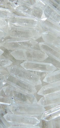 Clear quartz healing crystal pointed pendants for jewelry making, wire wrapping, crystal healing, feng shui, home decor, meditation and more at wholesale pricing for only $2.50 each at www.IndieFindings.com