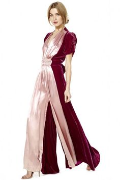 "1930s Two Tone Silk and Velvet Jumpsuit: ""Romance may not be easy in real life, but we're about to make falling in love as effortless as it gets. This handmade 1930s jumpsuit is dual-toned with fuchsia velvet and mauve silk paneling. It has gathering detail, extra wide pant legs and an adjustable front tie. Ain't love grand? Zip closure."" Photo: Nasty Gal, EBay"