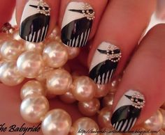 Beautiful black and white nails with tiny pearls.