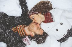 winter love story, a pair in love lying in the snow, kissing