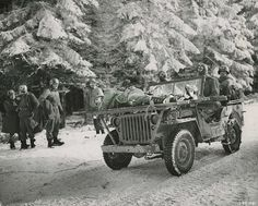 U.S. medics in Jeep Ambulance Medics of the 84th Division bring casualties back on their Jeep, near Samres, Belgium. They were part of the 1st Battalion 334th Infantry Regiment. Image was taken January 13, 1945.