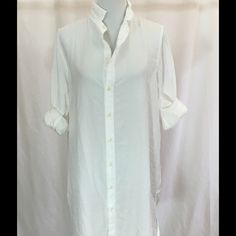 CP Shades Marlene Shirtdress - White Closet staple! Classic button down shirtdress with long sleeves and button cuffs. Shirttail hem. Can also be worn as a tunic, of course! Medium weight fabric of 65 Cotton/35 Silk twill. Machine wash. Made in USA. No trades. (3 available) Please leave the size you wish to buy in Comments below, and I'll make a separate listing for you! CP Shades Dresses