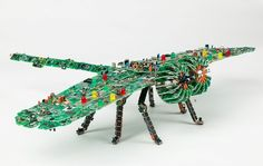 When Steven Rodrig was at Aviation High School in Long Island, the idea of creating the little sculptures from circuits and electronic parts took birth in his head, and the idea was tried out after he started repairing electronic equipments and instruments like computers.  His sculptures includes astonishing, life-like forms such as flowers, insects, and animals which are created out of old circuit boards and electronic parts