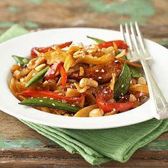 Asian-Style Chicken Pasta | This delicious stir-fried dish can be served hot or cold. Toss fresh vegetables and chicken in a tangy Asian sauce for a quick and tasty meal any day of the week. For extra nutrition, try using buckwheat noodles.
