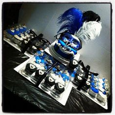 This was a last minute Sweet 16 Masquerade Party request. They wanted a cupcake tower (with 60 cupcakes) and a cupcake cake topper. I made the cupcake toppers in one day. Some of the masks had hand drawn designs and edible glitter. All the...