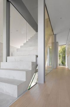 This really sleek staircase is gorgeous. The entry door would look great with an all silver u-locks on it!