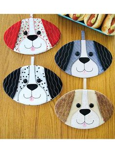 Hot Dogs Hot Pad Sewing Pattern - Smiling pups to help you with your cooking! This super-easy and fat quarter friendly pattern includes pattern pieces and full instructions to stitch up some really cute doggie pot grabbers/hot pads; your fingers slip easily into where the ears are ...