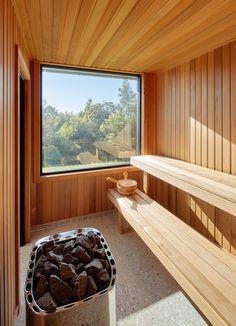 A contemporary sauna affords views of the surrounding property