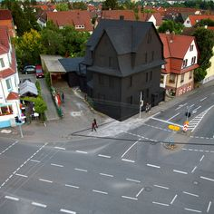 Haus in Schwarz (House in Black) was a 2008 piece by Erik Sturm und Simon Jung in Möhringen, Germany. The piece was meant as a farewell to the building slated for demolition, with the matte black paint acting as a sort of final curtain to an exterior that had recently been used by numerous street artists, shown above. UPDATE: After demolition, the owner, art gallery manager Karin Abt-Straubinger built a new gallery (but the House in Black still haunts Google Maps).