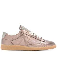 Shop Maison Margiela metallic low-top sneakers.