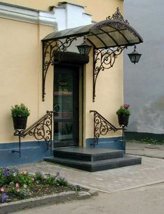 Welcoming wrought iron. Iron Doors, Wrought Iron Decor, Front Door Awning, House Entrance, Pergola Plans Roofs, House Designs Exterior, House Front Design, Gate Design, Iron Decor