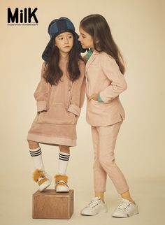 The littke girls outfit on the left-hooded sweater with knee socks