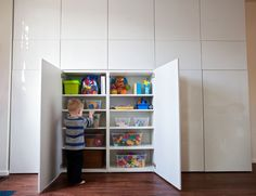 Our new basement cabinets! We used Ikea Besta modular cabinets, with their high-… Our new basement cabinets! We used Ikea Ikea Toy Storage, Playroom Storage, Basement Storage, Living Room Storage, Wall Storage, Home Living Room, Modular Cabinets, Ikea Cabinets, Trofast Ikea