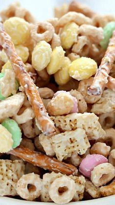 Bunny Bait aka Easter Snack Mix ~ Super delicious and easy to make... Made with cereal, pretzels, peanuts, pastel M&M candies and white chocolate – you can't go wrong!