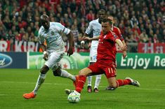 Ivica Olic (R) of Muenchen and Stephane Mbia (L) of Marseille battle for the ball during the UEFA Champions League quarter-final second leg match at Allianz Arena on April 3, 2012 in Munich, Germany.
