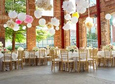 wide open spaces, exposed brick and hanging pom poms = gorgeous!