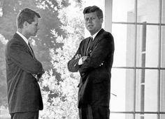 . President John F. Kennedy and Attorney General Robert F. Kennedy confer during the Cuban Missile Crisis in 1962.