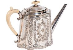 Antique sterling silver teapot with etched motif and ivory handle