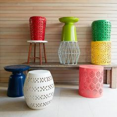 A punched pattern gives our drum stool a global-inspired edge. Finished in red, it makes a vibrant seat or accent table.