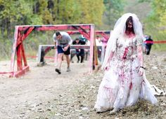 Ailie Herr of Lancaster, Pa., is a zombie bride roaming the 5K obstacle course as participants make their way through obstacles Saturday in Darlington.