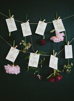 floral escort cards- could also do this using a string and flower backdrop and intersperse place cards