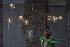 Lindsey Adelman: BB.07.04 with walnut arms, polished brass hardware and gold murrine globes #lighting
