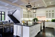 So much that I love about this open kitchen....white cabinets, island, dinning table right off kitchen
