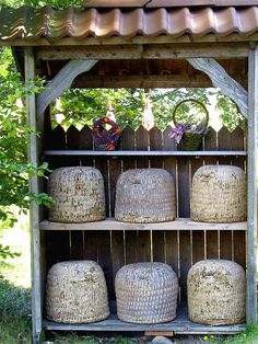 a stand of traditional bee skeps such as could be found in norther Germany...
