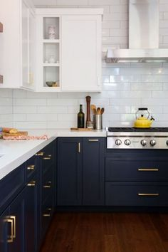 Navy blue cabinets with brass hardware, white subway tile, and white upper cabinets.Blue and White Kitchen Decor Inspiration 40 Home Decor Ideas to PIN Two Tone Kitchen Cabinets, Kitchen Cabinet Colors, Painting Kitchen Cabinets, Kitchen Cabinetry, Kitchen Tiles, Kitchen Colors, White Cabinets, Farmhouse Cabinets, Brass Kitchen