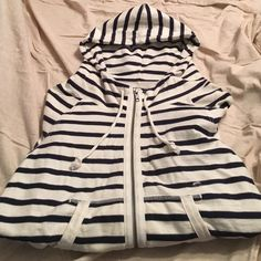 NWT American Eagle Striped Zip-Up Hoodie NEW WITH TAGS! AEO White and Navy Striped Zip-Up Hoodie with ties at the the bottom. Great Condition. Smoke Free! American Eagle Outfitters Tops Sweatshirts & Hoodies