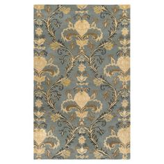 Wool rug with an oversized botanical ogee motif. Hand-tufted in India.  Product: RugConstruction Material: 100% ...