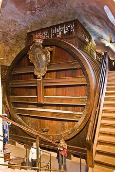 Heidelberg Castle's Haunted Wine Barrel. The world's largest wine cask, the Heidelberg Tun was built in 1751 from the trunks of 130 oak trees and has a capacity of 58,124 gallons. It is 28 feet deep by 23 feet high. The balustraded platform on top was built as a dance floor. #Germany #travel