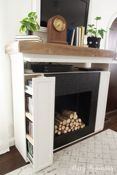 Fireplace with hidden storage! #hiddenstorage #spacesaver #spacesavingfurniture #multifunctional #multifuntionalfurniture #diy