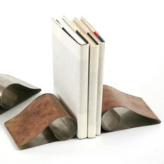 {Stainless Steel Curl Bookends} love these! very modern, yet with a rustic edge