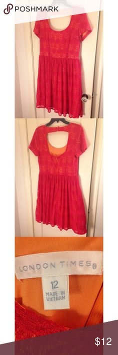 Pink lace dress with orange lining Cap sleeve, knee length pink and orange lace dress with an opening in the back. London Times Dresses Midi