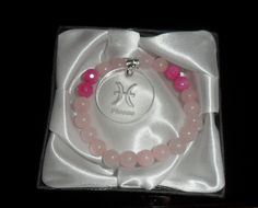 Bracelet made of semiprecious stones Rose Quartz and fuchsia with a sign of the zodiac