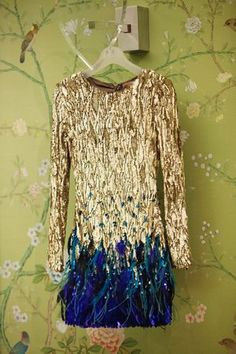 gold sequins and blue feathers - perfect for nye #nye